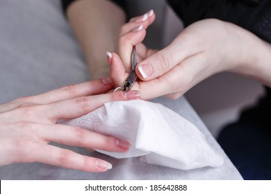 Creating a manicure, cuticle removal tool cuticle nippers shot closeup