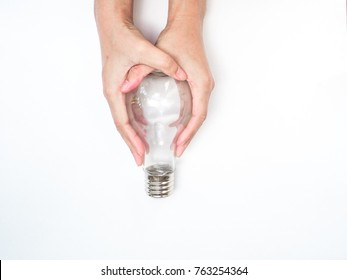 creation thinking outside box.hand hold light bulb on white background. isolated easy use for presentation screen or other.
