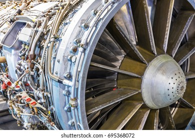 Creative abstract aviation industry technology concept: macro view of the airliner turbojet turbine engine equipment with selective focus effect