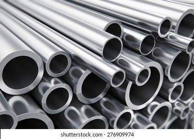 Creative abstract heavy metallurgical industry and industrial manufacturing business production concept: heap of shiny metal steel pipes with selective focus effect