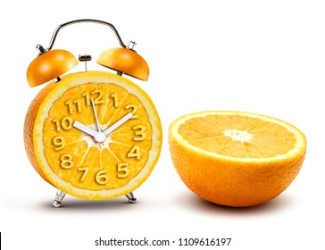 Creative alarm clock from half section orange crop isolated on white background with clipping path