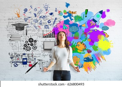 Creative and analytical thinking concept. Meditating young woman on brick background with colorful sketch and mathematical formulas