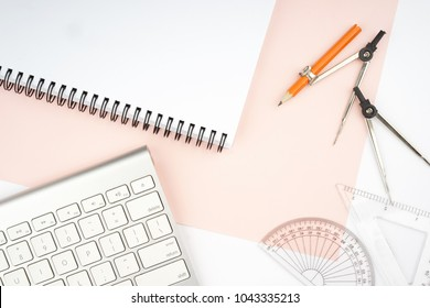 Creative arrangement of geometry stationery like protractor, metal compass on pastel paper. Education in mathematics, architecture and engineering concept. Flat lay.Copy space for text on notepad page