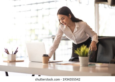 Creative Asian young woman working on laptop in her studio
