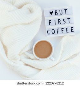 Creative autumn flat lay overhead top view coffee cup vintage lightbox But coffee first text sweater white background copy space minimal style Fall winter season template feminine blog social media