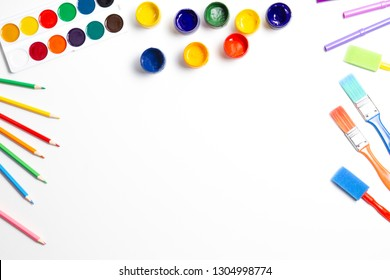 Creative background with art supplies on white table