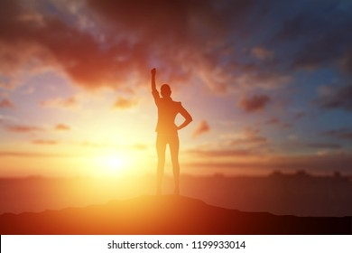 Creative background, business silhouette, business girl on the background of a beautiful, golden sunset. The concept of inspiration, enthusiasm, start-up, feminism symphony.