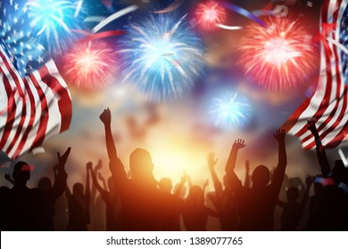 Creative background, a crowd of people on the background of a beautiful salute, the 4th of July, the American flag. Independence Day Banner of America, postcard, democracy