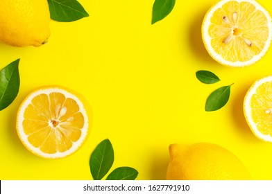 Creative background with fresh lemons and green leaves on bright yellow background. Top view flat lay copy space. Lemon fruit citrus minimal concept vitamin C. Composition with whole, slices of lemons - Shutterstock ID 1627791910