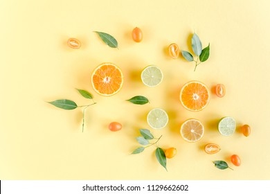 Creative background made of summer tropical fruits: grapefruit, orange, lemon, lime and leaves ficus. Food concept. flat lay, top view