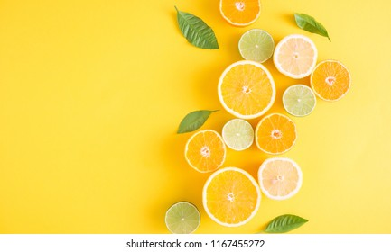 Creative background made of summer tropical fruits with leaves, grapefruit, orange, tangerine, lemon, lime on pastel yellow background. Food concept. Flat lay, top view, copy space - Shutterstock ID 1167455272