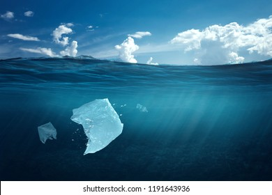 Creative background, plastic bag floating in the ocean, a bag in the water. The concept of environmental pollution, non-decomposable plastic, increased debris in the world's oceans.