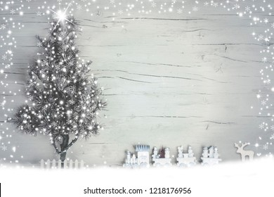 Creative beautiful Christmas background with wood white surface in frame of lights and glowing tree