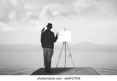 creative black and white painter observing the mist to find inspiration