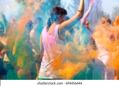 Creative blurred background of multicolored smoke from powders during Holi celebrations. Festival of Colored Paint, of colors love. Color fest