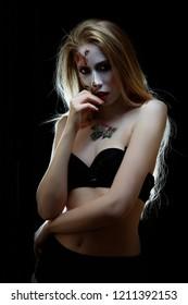 creative bodyart, red rose on girl skin in black swimsuit