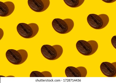 Creative bright collage of real macro photos of selected coffee beans on a yellow background with a hard shadow in the shape of a heart.