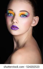 creative bright makeup. portrait of a girl model in the studio