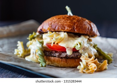 creative burger with pasta and salad