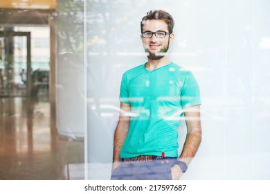 creative business person in a blank t-shirt, view through the window