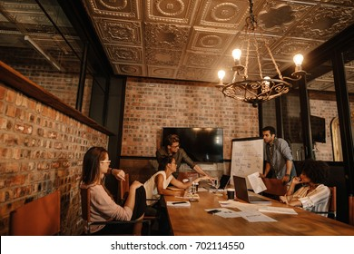 Creative business team meeting in conference room. Young professional team brainstorming in meeting in the creative office.