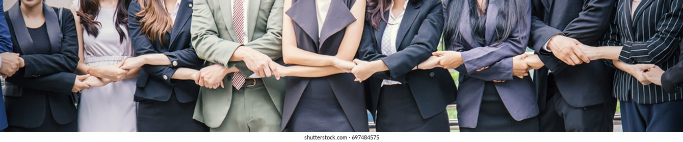 Creative business team meeting hands together in line, asian business people teamwork acquisition, brainstorm people concept. Startup friends creative people sale project panoramic banner