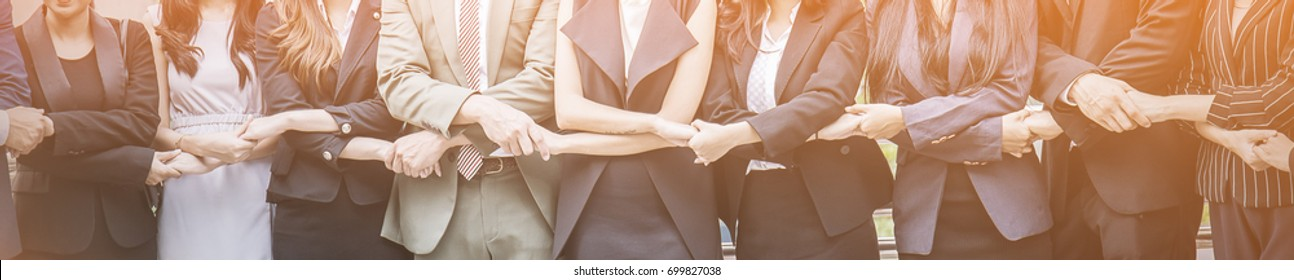 Creative business team meeting hands together in line, asian people teamwork acquisition, brainstorm business people concept. Startup friends creative people sale project panoramic banner