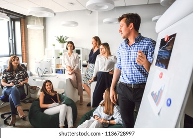 Creative business team in the office listening to the boss