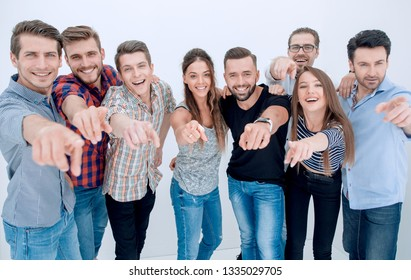 creative business team pointing at you