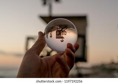 Creative californian baywatch house view thru a glass ball