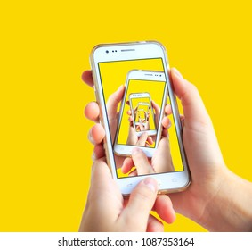 Creative cell phone concept on yellow background. Minimal. Flat.