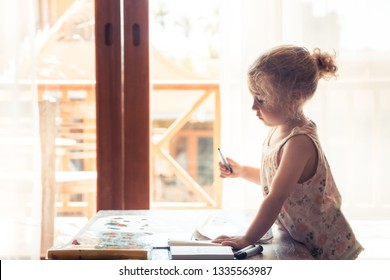 Creative child drawing in room with back light creative working painting process concept child art development