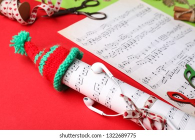 Creative Christmas composition with music sheets on color background
