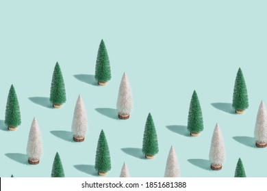 Creative Christmas pattern from Christmas tree on blue, New Year composition with copy space. Design for website, wrapping paper, wallpaper, screensaver.