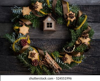 Creative Christmas Wreath in aged vintage wooden background. Idea for Christmas home decoration. Simple realistic photo