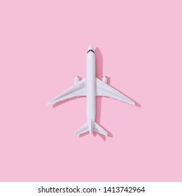 Creative composition made with passenger plane on pastel pink background. Summer travel or vacation concept.