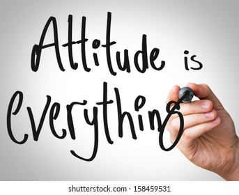 "Creative composition with the message ""Attitude is Everything"""