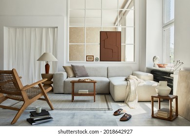 Creative composition of stylish and cozy living room interior with mock up structure painting, grey corner sofa, window, armchair and personal accessories. Beige neutral colors. Template.