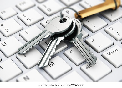 Creative computer internet security and PC web communication safety business technology concept: macro view of bunch of shiny metal keys with keychain for lock on white laptop or notebook keyboard