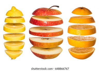 Creative concept with  Flying fruits. Sliced orange, lemon, apple isolated on white. Levity fruit floating in the air.