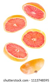 Creative concept with flying grapefruit. Sliced grapefruit isolated on white background. Levity fruit floating in the air