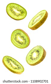 Creative concept with flying kiwi fruit. Sliced kiwi isolated on white background. Levity fruit floating in the air