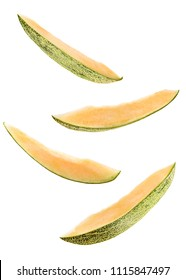 Creative concept with flying melon. Sliced four pieces of melon isolated on white background. Levity fruit floating in the air