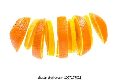 Creative concept with Flying orange and lemon slices. Sliced orange and lemon isolated on white background. Levity fruit floating in the air.