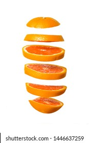 Creative concept with Flying orange. Sliced orange isolated on white background. Levity fruit floating in the air.