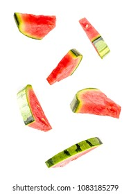 Creative concept with Flying watermelon. Sliced orange isolated on white background. Levity fruit floating in the air.