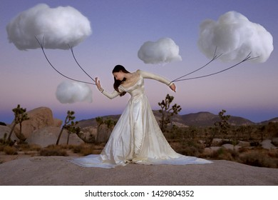 Creative Concept of Girl Attached to Clouds Representing Fantasy