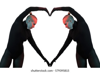 Creative concept, heart, symbol of love, formed by two female bodies mirroring each other, horizontal view against white background