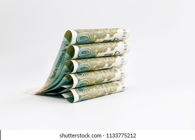 Creative concept of Pakistani currency bank note of 500 rupees rolled , isolated on white background.