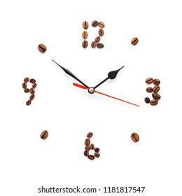 Creative concept photo of coffee clock made of beans on white background.